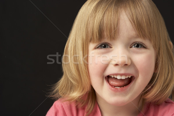 Close Up Studio Portrait Of Smiling Young Girl Stock photo © monkey_business