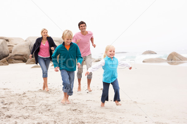 Young Family Running Along Winter Beach Stock photo © monkey_business