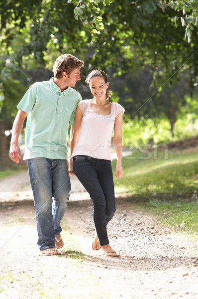 Affectionate Couple Walking In Countryside Together Stock photo © monkey_business