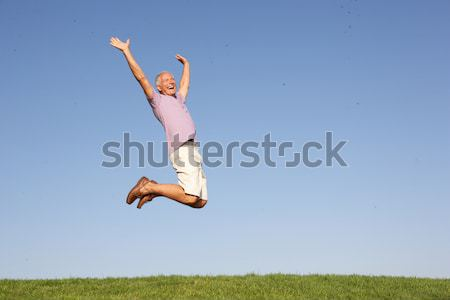 Young woman  jumping in air Stock photo © monkey_business