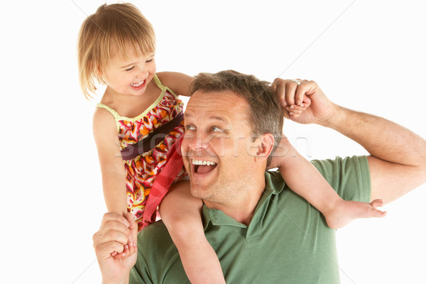 Young man carries child on shoulders Stock photo © monkey_business