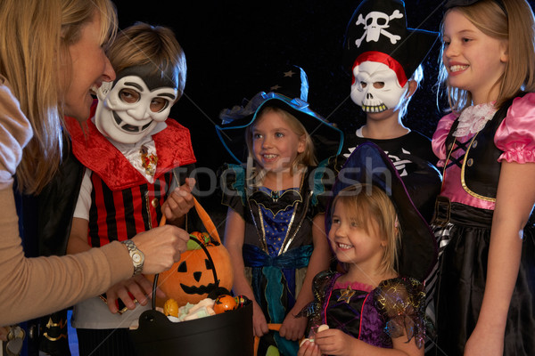 Happy Halloween party with children trick or treating Stock photo © monkey_business