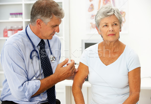 Doctor with female patient Stock photo © monkey_business