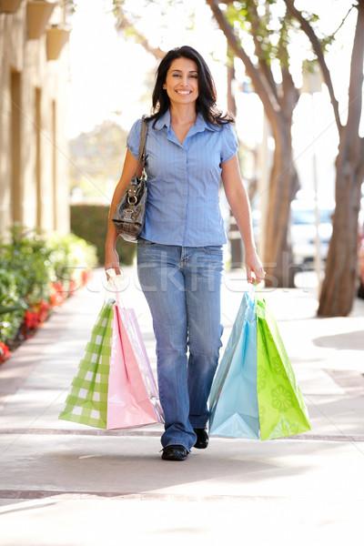 Hispanic woman carrying shopping Stock photo © monkey_business