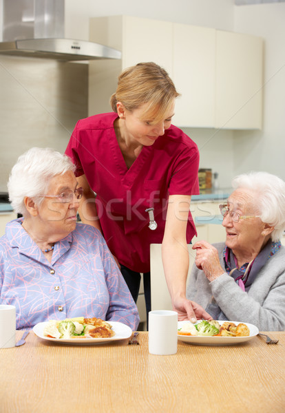 Altos mujeres cuidador comida casa Foto stock © monkey_business