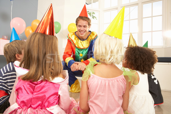 Clown entertaining children at party Stock photo © monkey_business