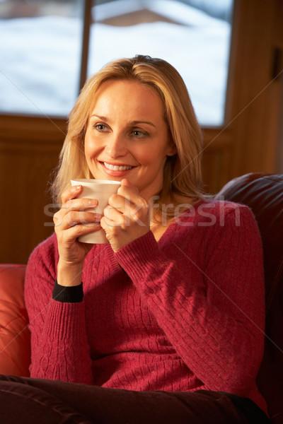 Détente boisson chaude canapé regarder tv Photo stock © monkey_business