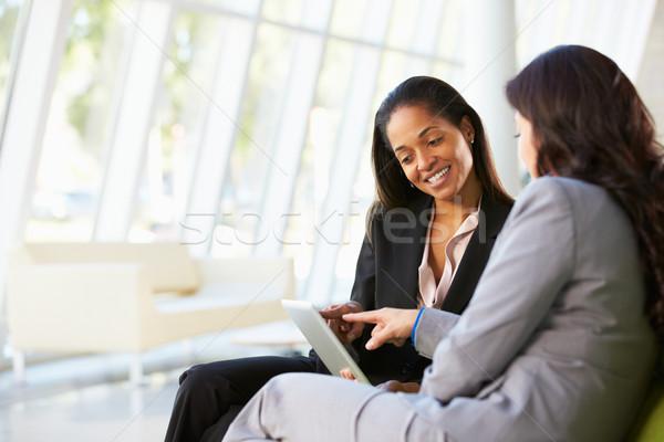 Businesswomen With Digital Tablet Sitting In Modern Office Stock photo © monkey_business