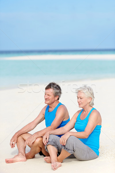 Sportkleding ontspannen mooie strand mannen Stockfoto © monkey_business