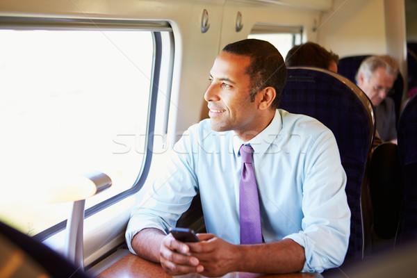 Zakenman woon-werkverkeer werk trein mobiele telefoon man Stockfoto © monkey_business