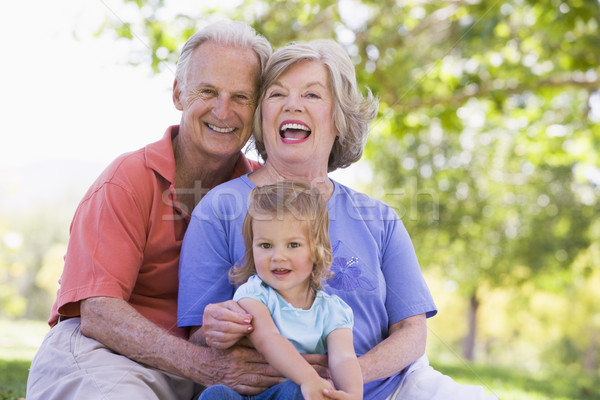 Grandparents with granddaughter in park Stock photo © monkey_business