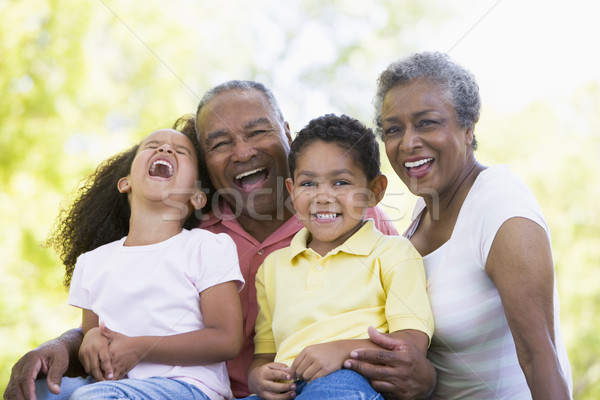 Grands-parents rire petits enfants famille enfant couple Photo stock © monkey_business