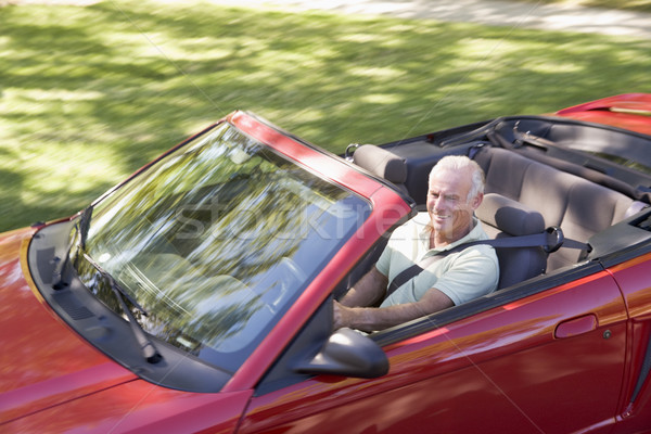 Man in convertible car smiling Stock photo © monkey_business