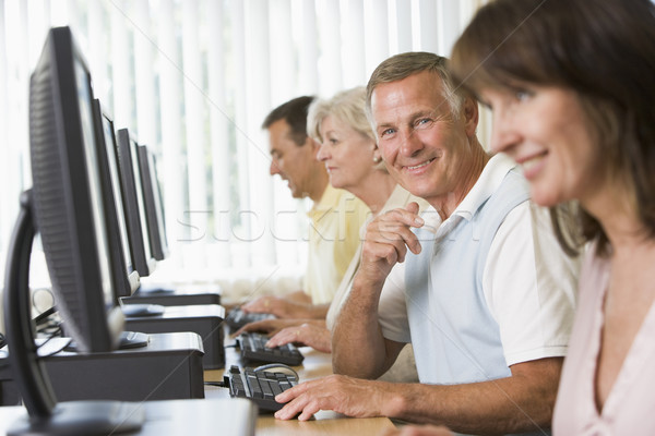 Stock photo: Adult students in a computer lab