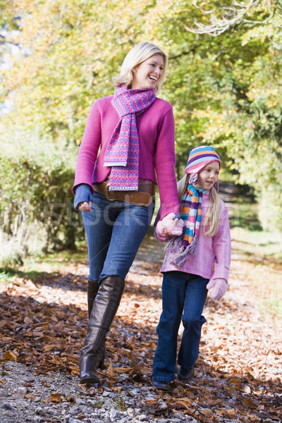 Mother and daughter walking along woodland path Stock photo © monkey_business