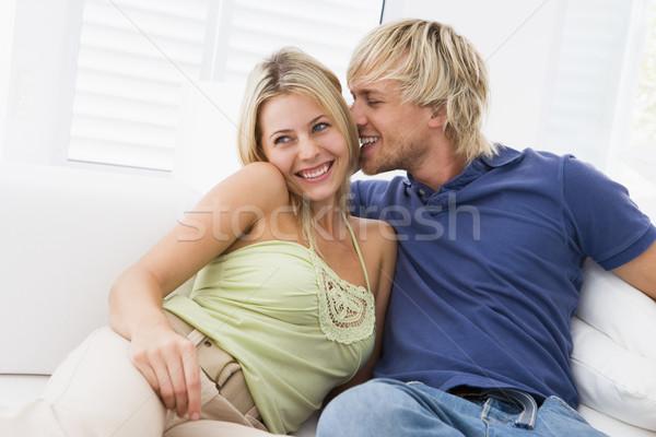 Сток-фото: пару · гостиной · целоваться · улыбаясь · любви · счастливым