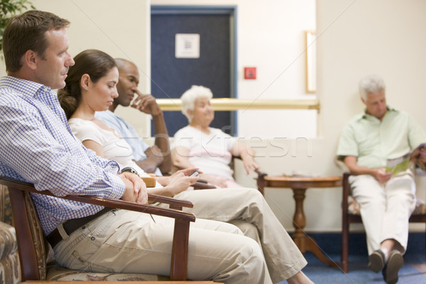 Stock photo: Five people waiting in waiting room