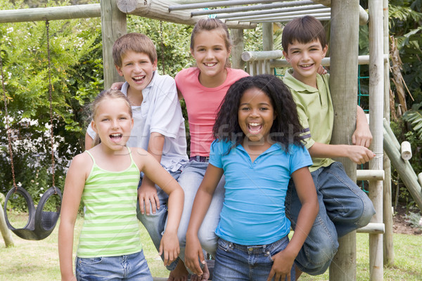 Five young friends at a playground smiling Stock photo © monkey_business
