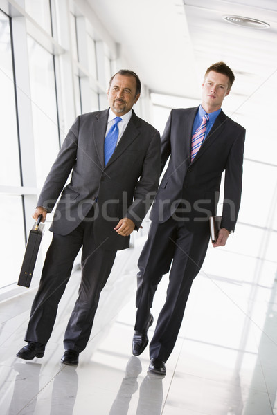 Two businessmen walking through lobby Stock photo © monkey_business