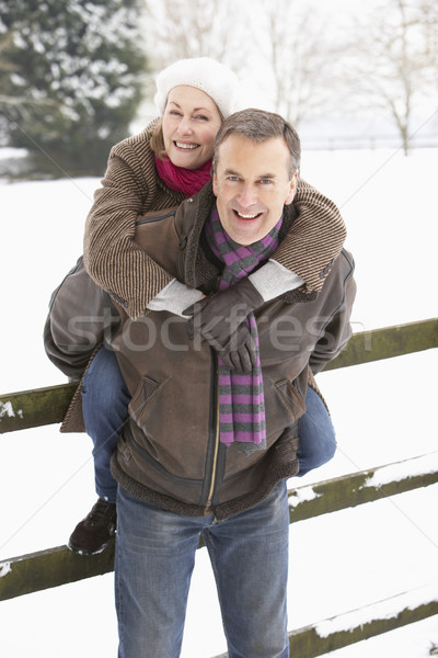 Senior Couple Standing Outside In Snowy Landscape Stock photo © monkey_business