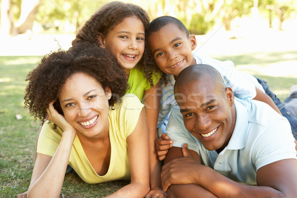 Portrait of Happy Family Piled Up In Park Stock photo © monkey_business