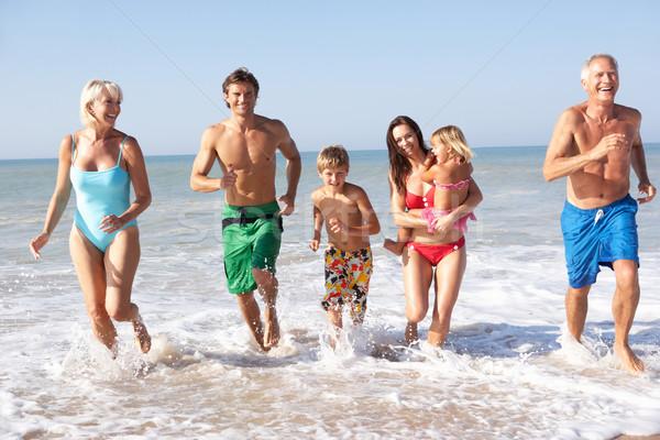 Three generation family play on beach Stock photo © monkey_business
