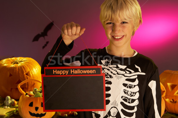 Halloween party with a boy child holding sign Stock photo © monkey_business