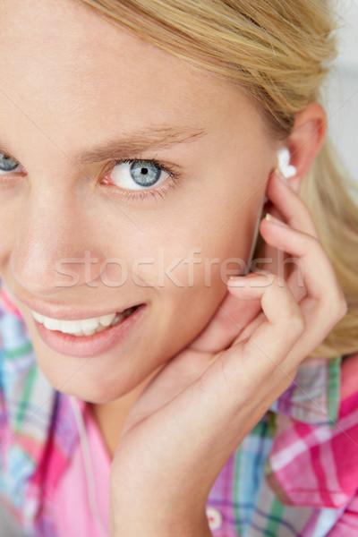 Teenage girl wearing earphones Stock photo © monkey_business