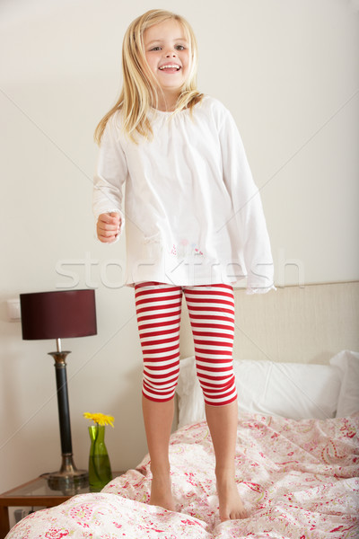 Young Girl Bouncing On Bed Stock photo © monkey_business