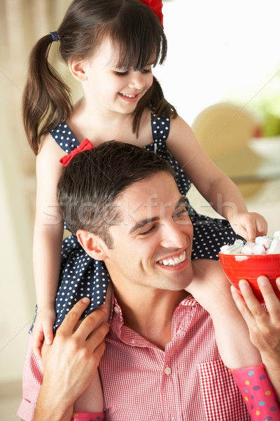 Father Giving Daughter Ride On Shoulders Indoors Whilst Eating M Stock photo © monkey_business