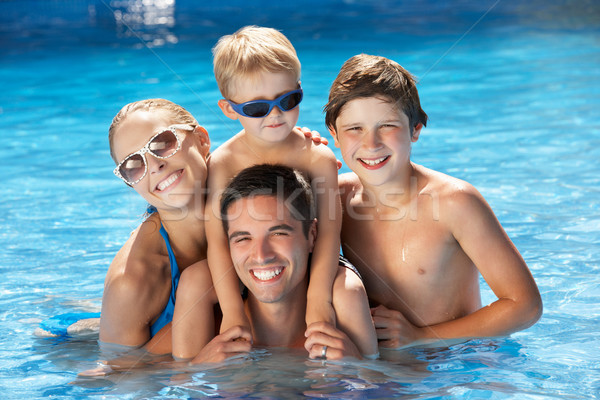 Family Having Fun In Swimming Pool Stock photo © monkey_business