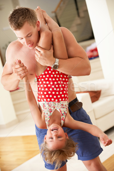 Father Holding Daughter Upside Down Stock photo © monkey_business
