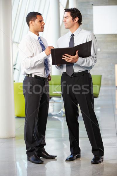 Dos empresarios informal reunión moderna oficina Foto stock © monkey_business