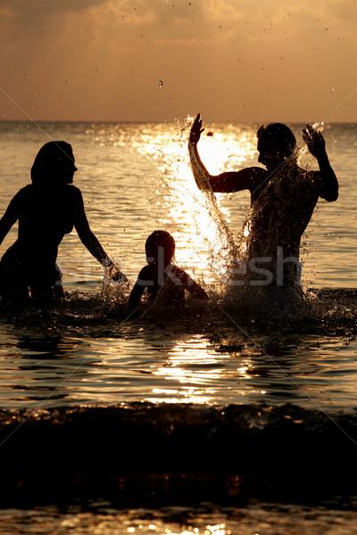 Siluet aile deniz kadın Stok fotoğraf © monkey_business
