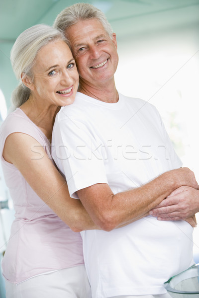 Couple embracing at a spa and smiling Stock photo © monkey_business