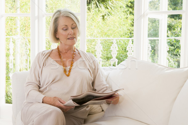 Woman in living room reading newspaper Stock photo © monkey_business