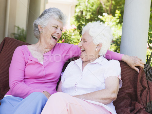Senior female friends laughing together Stock photo © monkey_business