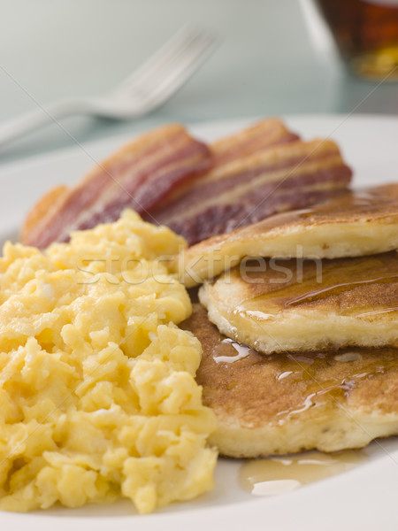 American Pancakes with Crispy Bacon and Scrambled Eggs and Maple Stock photo © monkey_business