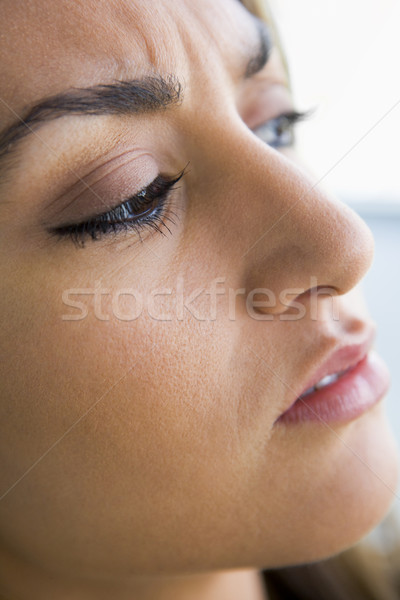 Stock photo: Head shot of woman scowling