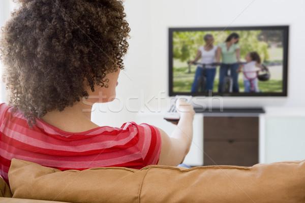 Stok fotoğraf: Kadın · oturma · odası · televizyon · teknoloji · portre