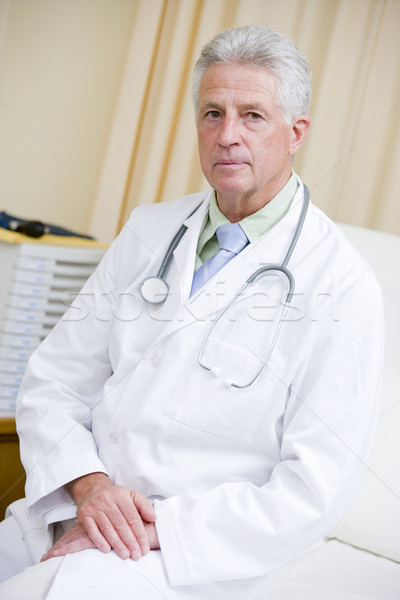 A Doctor Sitting On A Hospital Bed Stock photo © monkey_business