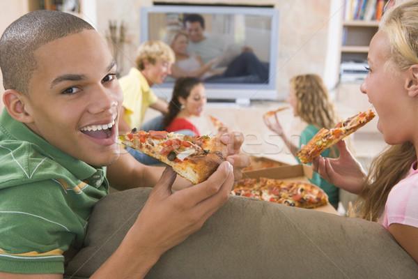 Stockfoto: Tieners · opknoping · uit · televisie · eten · pizza