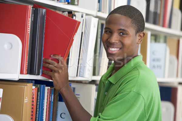 Stock photo: University student choosing book in library