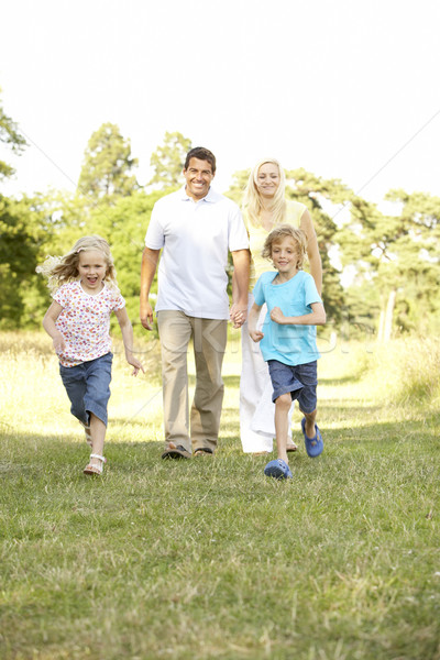 Family having fun in countryside Stock photo © monkey_business