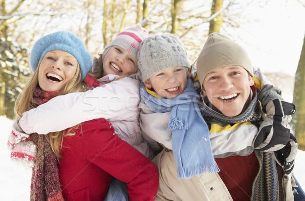 Family Having Fun Snowy Woodland Stock photo © monkey_business