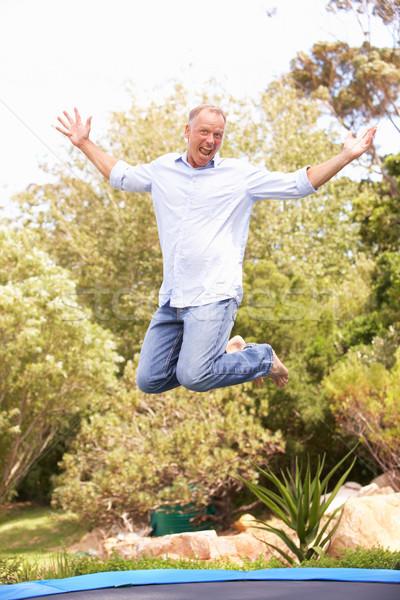 Saltando trampolim jardim homem retrato Foto stock © monkey_business