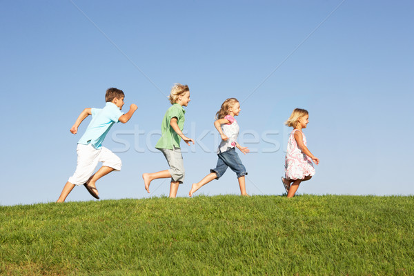 Young children running through field Stock photo © monkey_business