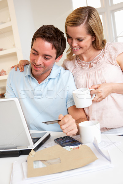 Young couple using credit card on the internet Stock photo © monkey_business