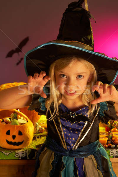 Halloween party with a child wearing scaring costume Stock photo © monkey_business