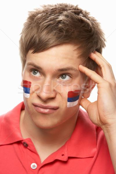Teleurgesteld jonge mannelijke sport fan vlag Stockfoto © monkey_business